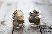 Постер, плакат: Glass Jars With Money Coins Ruble 10 Ruble Coins