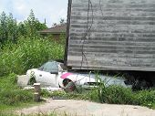 image of katrina  - a year later a house still rests atop a car where it landed during flooding from hurricane katrina in new orleans - JPG