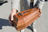 stock photo of urn funeral  - wooden coffin for dead animal - JPG