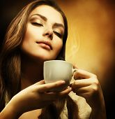 foto of beautiful women  - Beautiful Woman Drinking Coffee - JPG