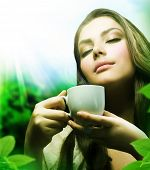 Beautiful Girl Drinking Healthy Green Tea.Healthcare or Herbal medicine concept