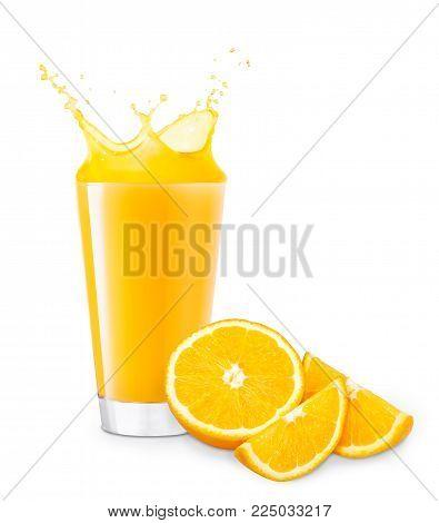 poster of glass of splashing orange juice with cutting orange fruit isolated on white background. Orange juice splash