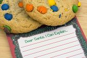 stock photo of letters to santa claus  - Cookies on note for Santa with a blank note - JPG