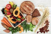 High fibre health food concept with fresh fruit, vegetables, wholegrain bread, nuts and cereals. Foo poster