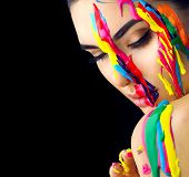 Fashion Model Girl colorful face paint. Beauty fashion art portrait of beautiful woman with flowing  poster