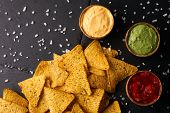 Mexican Nachos With Sauces Tomato Ketchup, Cheese And Guacamole In Wooden Bowl On Dark Background, T poster