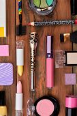 Colorful Cosmetics On Brown Workplace. Cosmetics Make Up Artist Objects, Top View. Fashion Design Co poster