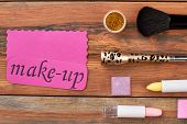 Brush And Cosmetics On Wooden Background. Cosmetics Set And Pink Card With Text Make-up. Feminine Co poster