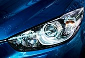 Blue Compact Suv Car With Sport And Modern Design Are Washing With Water. Car Care Service Business  poster
