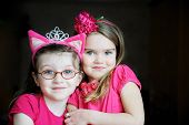 pic of pinky  - Portrait of two pinky child girls on black background - JPG