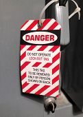 Lock Out Danger Tag Fastened To An Electrical Panel For Safety poster