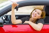Young Happy Attractive Woman Smiling Proud Sitting At Driver Seat Holding And Showing Car Key In New poster