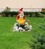 stock photo of hobgoblin  - garden gnome in front of a house - JPG