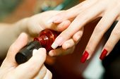 foto of nail salon  - A young woman having manicure at a nail salon - JPG