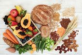 Healthy high fibre diet food concept with legumes, fruit, vegetables, wholegrain bread, cereals, gra poster