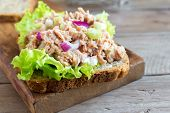 Tuna Salad Sandwich Over Wooden Background, Close Up. Homemade Sandwich With Tuna And Vegetables For poster