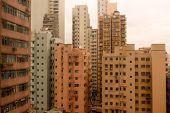 Landscape Of Rooftops Of The Orange Buildings In Hongkong poster