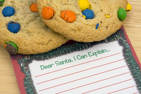 image of letters to santa claus  - Cookies on note for Santa with a blank note - JPG