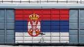 Front View Of A Container Train Freight Car With A Large Metal Lock With The National Flag Of Serbia poster