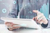 Businessman Analyzing Financial Data. Virtual 3d Interface Above Tablet Computer Screen. Interactive poster