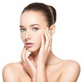 Young woman with healthy clean skin touches the face - isolated on white.  Skin care concept. poster