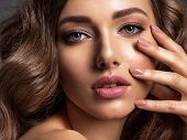 Beautiful woman with natural color of nails. Beautiful face of an attractive model with fashion make poster
