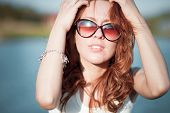 Redhead Girl In Sunglasses. Close-up. Emotions. Young Redhead Girl Relaxing In Sunglasses. Woman Rel poster