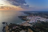 Aerial View Of The Zambujeira Do Mar Village And Beach At Sunset, In Alentejo, Portugal; poster
