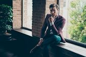 Photo Of Chic Business Guy Looking Clever Eyes Deeply Thinking Sitting Window Sill Hand On Chin Wear poster