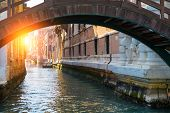 Beautiful Venice Canal In Early Morning Light. Old Narrow Canal With One Parked Boats, Venice, Italy poster