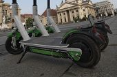 Electric Scooters Are Parked At The Gendarmenmarkt In Berlin. A Number Of E-scooters On The Backgrou poster