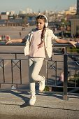 She Loves A Good Sound. Little Girl Wearing Earphones Playing Electronic Sound On Urban Background.  poster