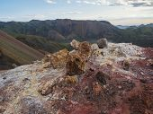 Colorful Rhyolit Red And Orange Fumarole At Foot Of Brennisteinsalda Mountain With Panorma Of Landma poster