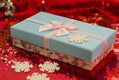 Gift Boxes Lie On A Red Shiny Fabric. Package Of Gifts For Christmas.bokeh, Small Tree, Bright Festi poster