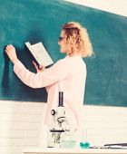 Student Writing Chalkboard Defocused. Biology Concept. Biology Laboratory. Microbiology And Bioengin poster