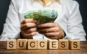 Wooden Blocks With The Word Success And Businessman With Money. Successful Business Concept. The Gro poster