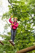 Adventure Climbing High Wire Park. Child Climbing On High Rope Park. Beautiful Little Child Climbing poster