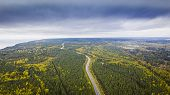 Aerial View Of A Car On The Road. Autumn Landscape Countryside. Aerial Photography Of Autumn Forest  poster