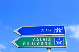 pic of road sign  - A French road sign pointing the way to Calais and Boulogne two famous channel ports for ferry travel to the UK - JPG