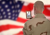 picture of conscript  - Conscript  marine looks at the photo of the girlfriend - JPG