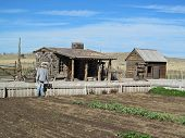 picture of blacksmith shop  - View of the garden and blacksmith shop at the pioneer era village at Cove Fort - JPG