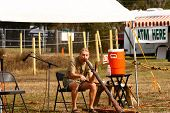 stock photo of didgeridoo  - An exotic flute player playing a Australian didgeridoo at a local powwow in Florida - JPG
