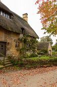 foto of english cottage garden  - Thatched cottage in Stanton in Cotswold or Cotswolds district of southern England in the autumn - JPG