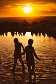 Children Playing At Sunset In Temple Of Debod Park, Madrid