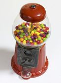 picture of gumball machine  - Red Gumball Machine on a white table - JPG