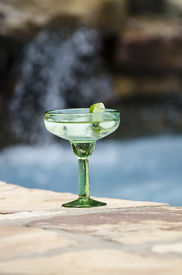 stock photo of skinny-dip  - Margarita waiting by the side of the pool - JPG