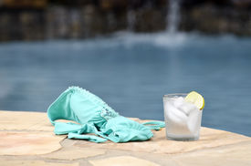 stock photo of skinny-dip  - bikini and cold drink by the water edge