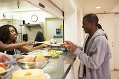 picture of homeless  - Kitchen Serving Food In Homeless Shelter - JPG