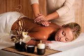 foto of massage therapy  - professional masseur doing massage of female back in the beauty salon - JPG