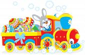 stock photo of cony  - Easter rabbit on a train carrying colorfully decorated Easter eggs in a carriage - JPG